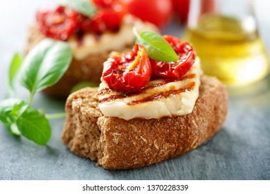 Wholegrain rusk with haloumi and sundried tomato