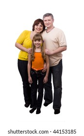 Whole-length portrait of happy family. Mother, father and little daughter are smiling. Woman, man and girl are lying on the floor and posing happily on white background.