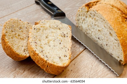 Wholemeal bread sliced on wooden table