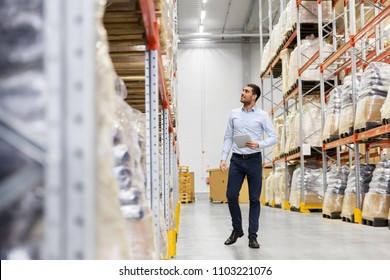 wholesale, logistic business, export and people concept - happy businessman with tablet pc computer checking goods at warehouse