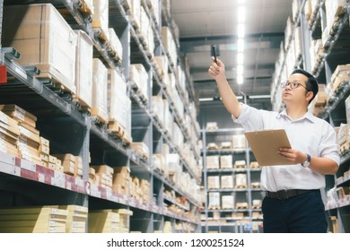 Wholesale, logistic, business, export and people concept - Man warehouse worker checking goods at warehouse.