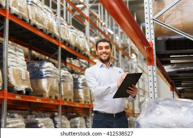 wholesale, logistic, business, export and people concept - man or manager with clipboard checking goods at warehouse