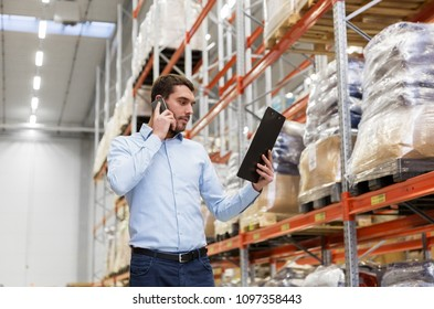 wholesale, logistic business, technology and people concept - businessman calling on smartphone at warehouse