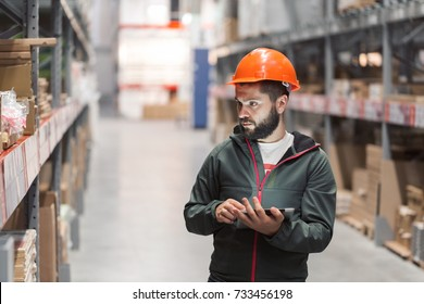 wholesale, logistic, people and export concept - manager or supervisor with tablet at warehouse