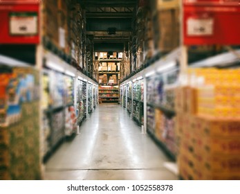 Wholesale store aisle with products blurry