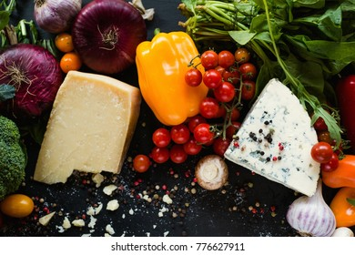 Wholesome nutrition. Italian salad ingredients. Vegetables and cheese assortment.