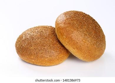 Wholesome round bran bread on white background