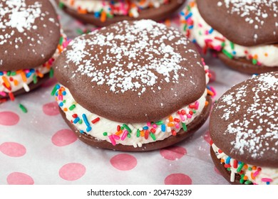 Whoopie pies, chocolate cake desserts, decorated with sprinkles and sugar, shallow depth of field