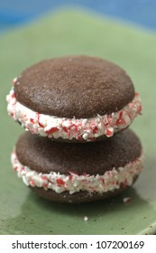whoopie pies, a cookie with a creamy center.  these are decorated for Christmas with a candy cane dusting