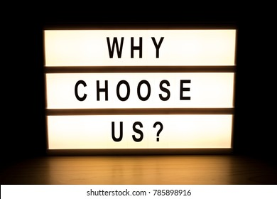 Why choose us light box sign board on wooden table.