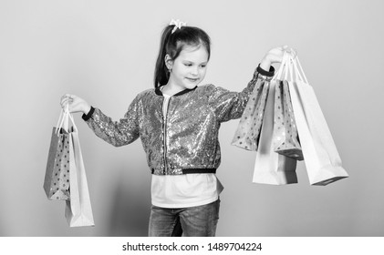 Why not. Cheerful child. Little girl with gifts. Mall. Sales and discounts. store retail. Holiday purchase saving. Fashion and style. customer with package. Small girl with shopping bags.