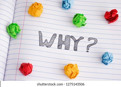 Why? Why question on notebook sheet with some colorful crumpled paper balls on it. Close up.