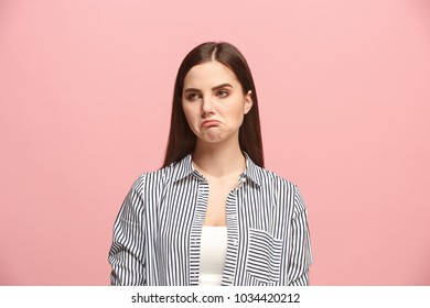 Why is that. Beautiful female half-length portrait isolated on trendy pink studio backgroud. Young emotional sad, frustrated and bewildered woman. Human emotions, facial expression concept.