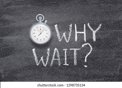 why wait question written on chalkboard with vintage precise stopwatch