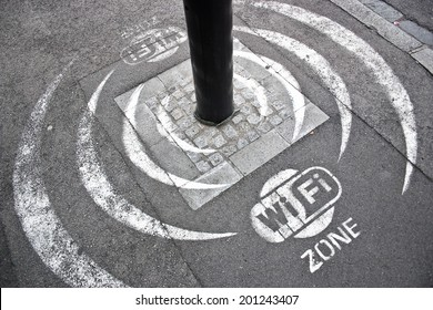 Wi Fi zone sign on the asphalt street.