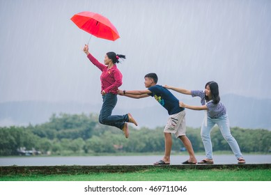 Wiang Chiang Rung , Thailand - August 12 : The family with an umbrella in Wiang Chiang Rung Rai Wiang Chiang Rung in Thailand on August 12, 2016 .