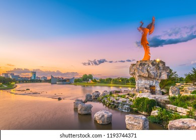 WICHITA, KANSAS - AUGUS 31, 2018: Downtown Wichita at dawn from the Arkansas River and Keeper of the Plains.