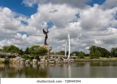 WICHITA, KANSAS - AUGUST 13: Keeper of the Plains steel sculpture on the Arkansas River on August 13, 2017 in Wichita, Kansas