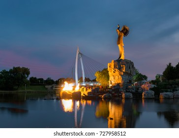 WICHITA, KANSAS - AUGUST 13: The lighting of the fire at the Keeper of the Plains steel sculpture (44 feet high) on the Arkansas River on August 13, 2017 in Wichita, Kansas