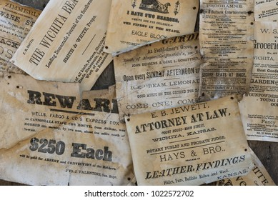 Wichita, Kansas / October 14, 2015: These old advertisements are posted at Old Cow Town which  is a living history museum that recreates a frontier settlement on the Chisholm Trail of the late 1800's.