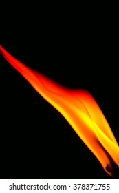 Wick and flame macro on a black background.