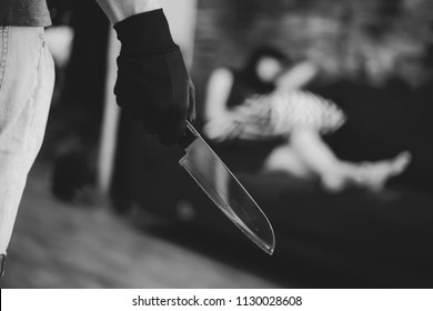 Wicked and evil murderer attempt to kill a woman in danger with a knife - homicide and violence society problem concept - in black and white color tone