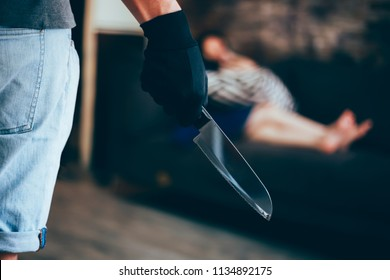 Wicked and evil murderer attempt to kill a woman in danger with a knife - homicide and violence society problem concept