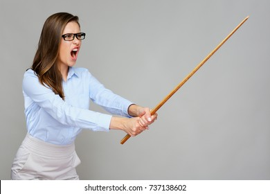 Wicked woman teacher screams, holding pointer wand. Isolated portrait,