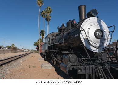 Wickenburg, Arizona - Nov. 19, 2018: The A.T. and Santa Fe railroad engine 761 built in 1890 is located by the Chamber of Commerce Visitor's Center which in inside the old Santa Fe Depot building.