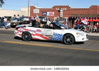 Wickenburg, Arizona / USA - February 8, 2008: Maricopa County Sheriff Joe Arpaio waves to the crowd at Gold Rush Days Parade