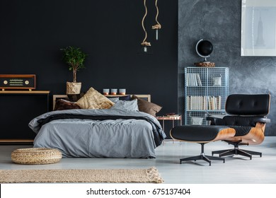 Wicker accessories in black and grey modern bedroom