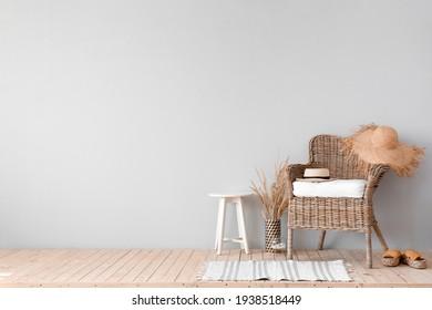 Wicker armchair in interior of living room