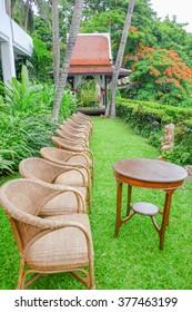 wicker armchair on cafe terrace in garden