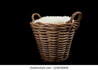 Wicker basket against a black background