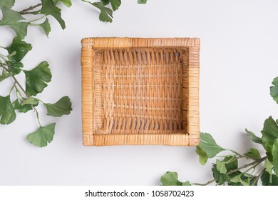 Wicker Basket with Branches Flat Lay Top View