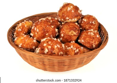 Wicker basket of chouquettes close-up on white background