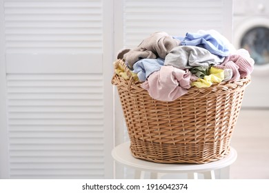 Wicker basket with dirty laundry indoors, space for text - Shutterstock ID 1916042374