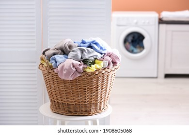 Wicker basket with dirty laundry in room