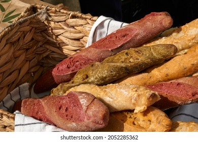 a wicker basket filled with fresh baguettes stands on a table at a fair in europe. High quality photo