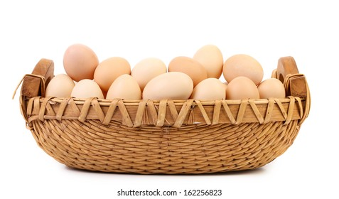 Wicker basket fool with eggs. Isolated on a white background.
