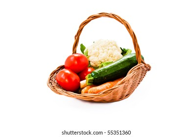 Wicker basket with fresh vegetables from the market