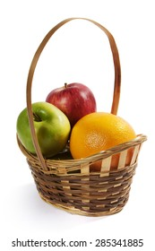 Wicker basket with fruit. Apples and grapefruit.