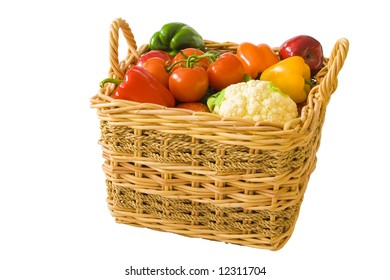 A wicker basket full of brightly colored produce.