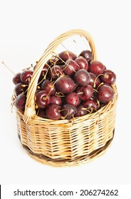 Wicker basket full of cherry berries