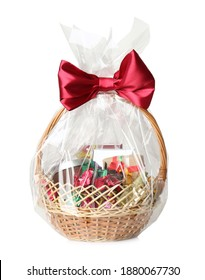 Wicker basket full of gifts isolated on white - Shutterstock ID 1880067730