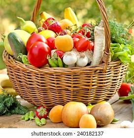 Wicker basket full of healthy food (organic and fresh food)