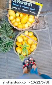 Wicker basket full of lemons on the italian street of Corniglia in Chinque Terre