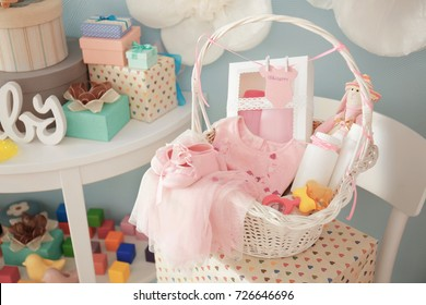 Wicker basket with gifts for baby shower indoors