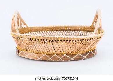 Wicker basket is handmade on white background.