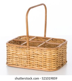wicker basket for holding bottles of wine on white background